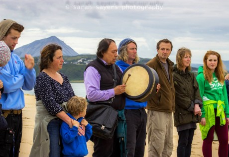 Local people gather with Native American Indian Gary (White Deer) for special prayers and a blessing of family of whales that died at Ballyness beach, Falcarragh, Donegal. Photo courtesy of Sarah Sayers