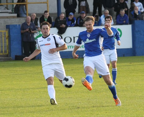Keith Cowan gets the ball forward for Finn Harps against Waterford United.