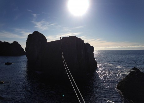 A tyrolean traverse off a sea stack at An Port, located along the coast between Ardara and Glencolmcille. Photo: courtesy of Iain Miller.