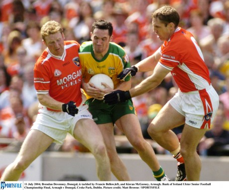 Brendan Devenney, Donegal, is tackled by Francie Bellew,left, and Kieran McGeeney in the 2004 Ulster final.