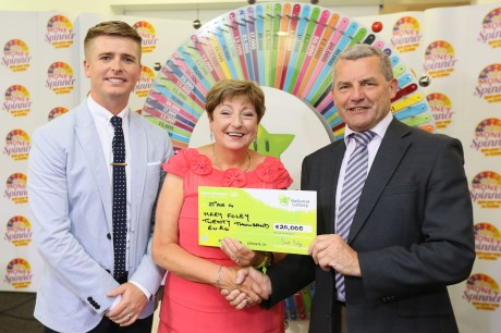 Mary Foley from Letterkenny, Co. Donegal won €20,000, including a city break at the National Lottery's Money Spinner event held at National Lottery offices in Dublin on Saturday 23rd August 2014. Pictured at the presentation of winning cheques were, from left to right: Brian Ormond, Money Spinner Host; Mary Foley, the winning player and Gerry O'Donoghue, The National Lottery. The winning ticket was purchased in Reidy's Centra, Coyrig, Foynes, Co. Limerick. Pic: Mac Innes Photography