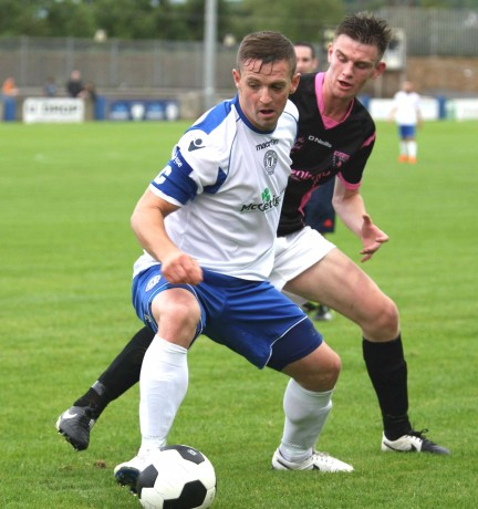 Kevin Mc Hugh holds off his marker during the Finn Harps versus Wexford Youths match at Finn Park on Friday night. Photo: Gary Foy