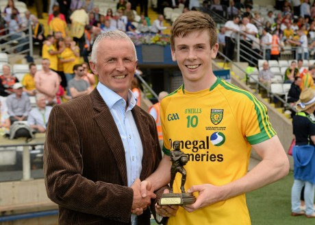 Eoghan Ban Gallagher receives the Man of the Match award at the Ulster final from Electric Ireland's Vincent Litchfield