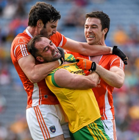 Armagh's Aaron Findon, left, gets involved, and was later given a yellow card, in the altercation between Karl Lacey and Aidan Forker