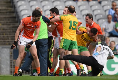 Aaron Findon, Armagh, pushes Donegal team doctor Kevin Moran during an altercation in the first half.