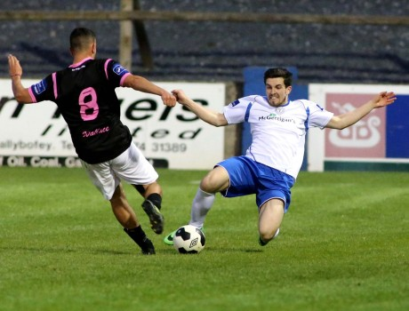 Brian McGroary announces his arrival on Finnside with this important tackle on Shane Dunne of Wexford Youths. The Drimarone native made his first Finn Park appearance for Ollie Horgan's Harps as a sub last week. Photo: Gary Foy