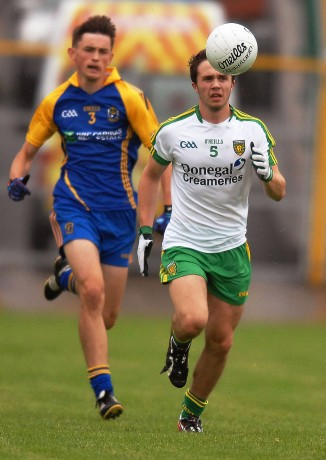 The outstanding Cian Mulligan, coming forward for Donegal, with Roscommons Brian Stack in his slipstream.