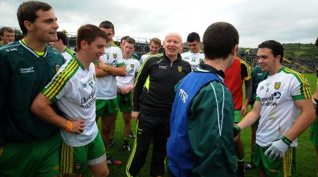 Declan Bonner, and his happy men after the win over Roscommon, which takes them to a semi final in Croke Park.