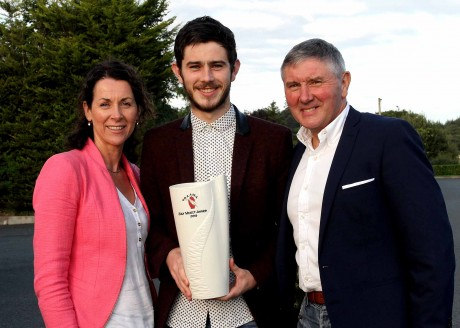 Ryan McHugh, July UGAAWA Merit Award winner, with parents, Martin and Patrice, at the presentation in Quinn's Corner.