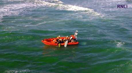 The surfers being brought onto the lifeboat yesterday evening.