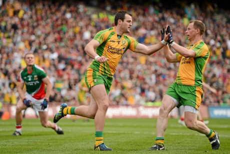 Michael Murphy, Donegal, celebrates with team-mate Anthony Thompson after scoring a goal in the 2012 All-Ireland final.