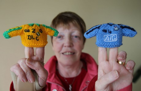 Grainne Shiels with her knitted bottle top hats.