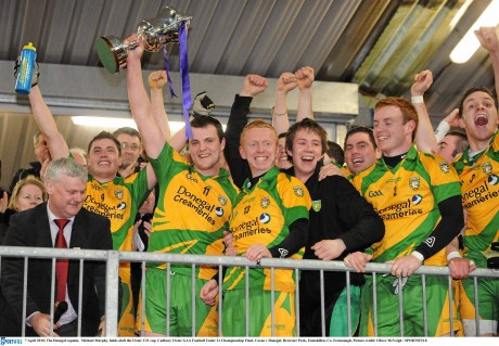 James Carroll pictured next Michael Murphy as the Donegal captain lifts the Ulster Under-21 Cup in 2010. Carroll will be back from Abu Dhabi for this weekend's All-Ireland finals