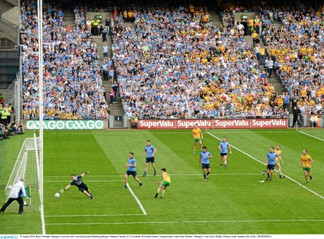 Ryan McHugh, Donegal, scores his side's second goal past Dublin goalkeeper Stephen Cluxton.