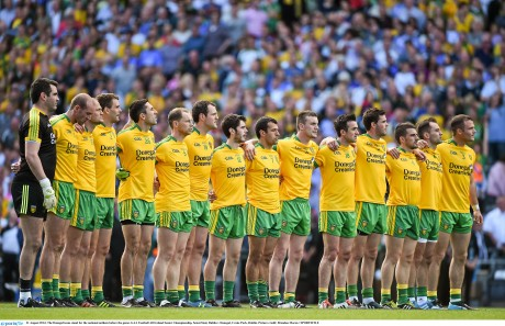 The Donegal team stand for the national anthem before the game against Dublin