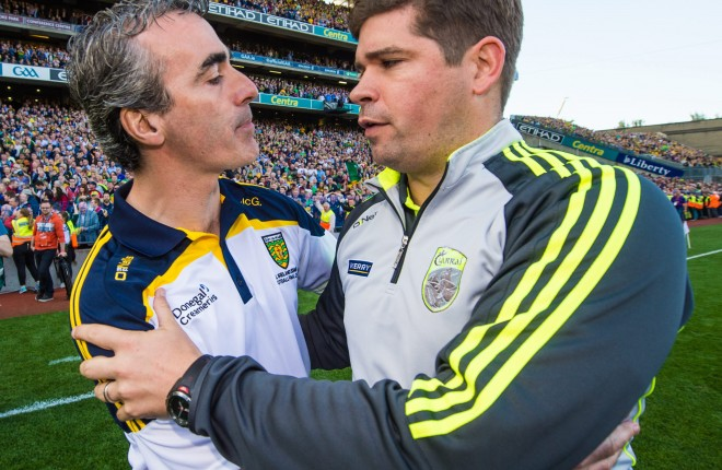 Jim McGuinness with Eamonn Fitzmaurice after the 2014 all-Ireland Final