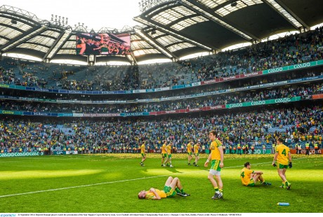 Dejected Donegal players watch the presentation of the Sam Maguire Cup to the Kerry team.