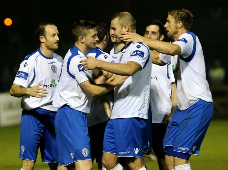Harps players celebrate going four up against Avondale thanks to Kevin McHugh's penalty. Photo: Gary Foy