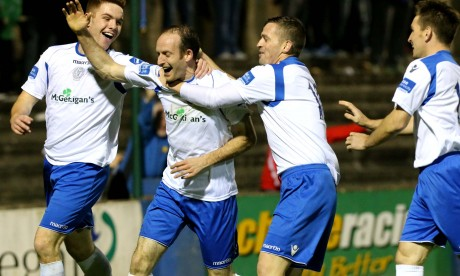 Sean McCarron, Kevin McHugh and Ger O'Callaghan celebrate with Michael Funston after he scores Harps' third goal. Photo: Gary Foy