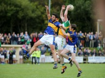 Glenswilly's Ciaran Bonner under pressure from Kilcar's Michael Hegarty. Photo: Declan Doherty