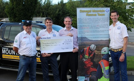 Anraí O Domhnaill presenting a cheque for  Euro: 7000.00 to Brian Murray, Joseph Brennan and Gerard Murray for Donegal Mountain Rescue Team. The money was raised from the recent Errigal climb where Anraí congratulated the DMRT members on a very wet afternoon after summitting Errigal for the 1000th time.