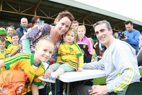 Jim McGuinness with Diane Gallagher, Connor and Abbigal McCahill at the fan day in Ballybofey.  Photo Brian McDaid