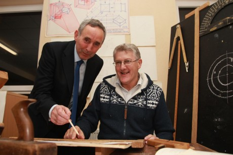 Hugh McAuley, who was a student at the Letterkenny Vocational School in the 1970s, pictured looking at mechanical drawing exercises he drew as a student. He is pictured with the present-day Principal of Errigal College, Mr Charlie Cannon, at the launch of the school's centenary. Photo: Brian McDaid
