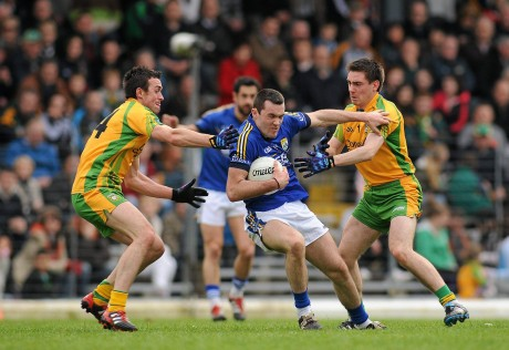 David Walsh and Martin O'Reilly in action against Kerry's Brian McGuire in a League game in 2012