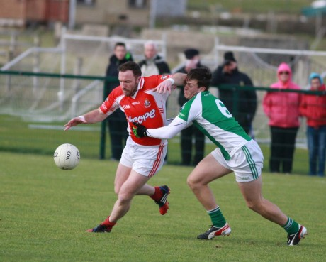 Adrian Sweeney in action for Dungloe in the game against Gweedore's Shaun Sharkey. Photo Brian McDaid