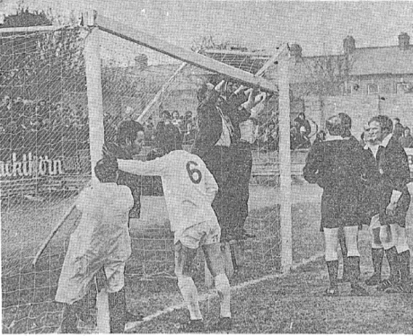 Repairs to the crossbar at Oriel Park in 1974