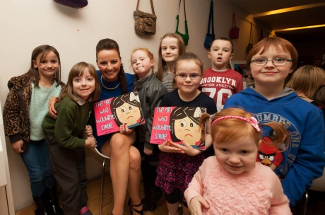 Sarah with young fans at the launch of her book, The Girl Who Wouldn't Smile.