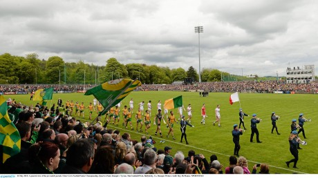 Donegal and Tyrone in the pre-match parade at Sean MacCumhaill Park in May 2013