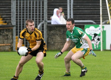 St Eunan's Conal Dunne in action against Eamon Ward of Glenswilly.
