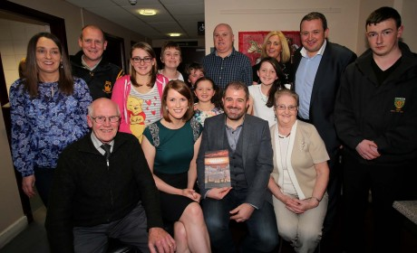 Kieran Kelly with his parents Hugh and Bridget, fiance Olivia Wilson and family members at the launch of the book.