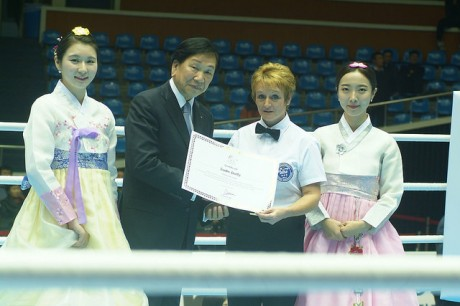 Sadie Duffy receives her certificate from Dr CK Wu, the AIBA President