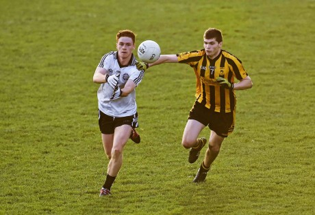 Conor Meyler, Omagh St Enda's, in action against Darragh Mulgrew, St Eunan's.