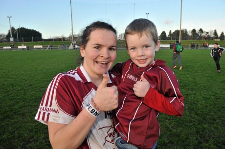 Geraldine McLaughlin celebrates with her nephew, Oran Hilley, after helping Termon into the All-Ireland final.