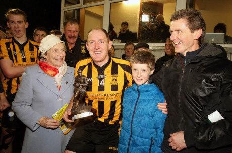 John Haran receives his Man of the Match award - the Peadar McGeehin Memorial trophy - from members of the McGeehin family on Sunday. Photo: Declan Doherty