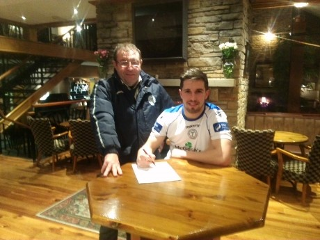 Brian McGroary signs for Finn Harps in the company of club secretary John Campbell