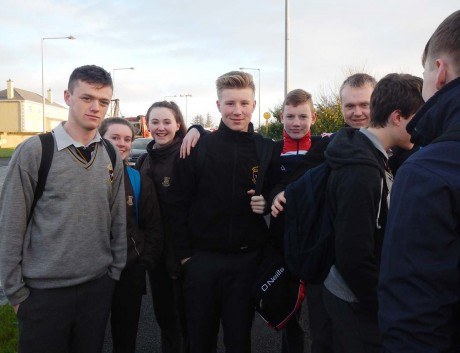 Some of the students who were evacuated from the burning bus.