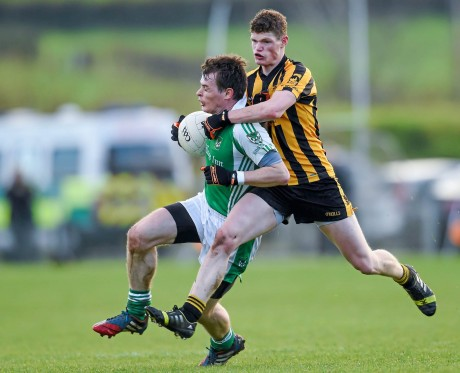 Peter Sherry, Roslea Shamrocks under pressure from Conor Morrison, St. Eunan's. Morrison is expected to play in Sunday's semi-final having been forced off injury in last week's quarter-final.