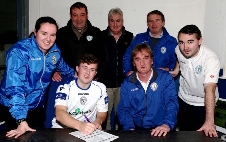 Tony Mc Namee puts pen to paper for Finn Harps as manager Ollie Horgan, Chantelle Grant, John Campbell, James Rodgers, Aidan Campbell and Shane Elliott look on. Photo: Gary Foy