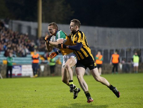 St Eunan's Sean Hensey puts Gary McFadden of Glenswilly under pressure in the county final.