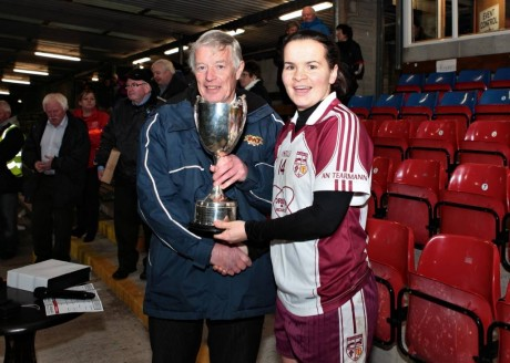 Geraldine McLaughlin is presented with the Ulster Cup following Sunday's game.