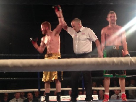 Brad Botham's hand is raised following his win over Shaun McShane