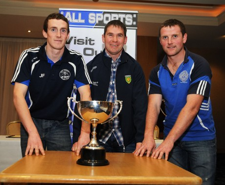 Martin McShane, [centre] from Ardara, who is referee for the reserve game. He's pictured with captains Jerry Friel and Eugene Maguire.