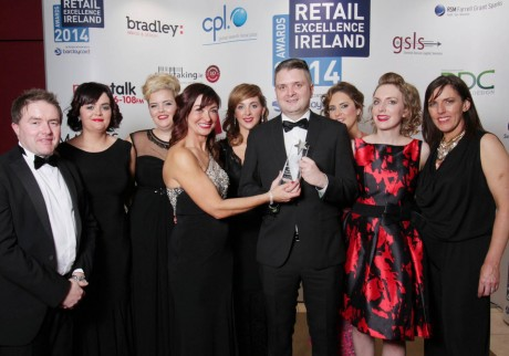 Mr Peter Sweeney of Barclaycard (event sponsors) and Ms Oonagh O'Hagan chairperson of Retail Excellence Ireland with Martin McElhinney and his team from McElhinney's of Ballybofey at the Retail Excellence Ireland Awards 2014.  Photo:- Andrew Downes Photography.