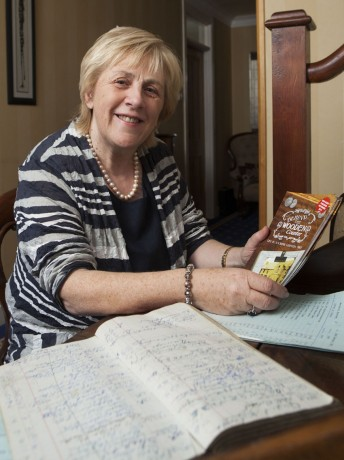 Pearl Hutchinson looks over some of the ledgers from her father's shop in Glenfin.