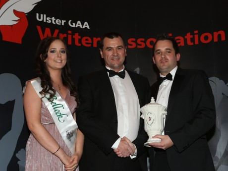 UGAAWA member Chris McNulty presents the Personality of the Year Award to Donegal county chairman Sean Dunnion who accepts it on behalf of Donegal manager Jim McGuinness while included is Maeve of trophy sponsors Belleek Pottery.  Pic by John McIlwaine