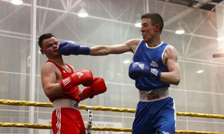 Noel McBride (blue) lands a punch